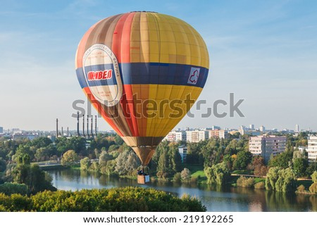 Minsk, Belarus. 12-September-2014: view of hot air baloon flying over Minsk city at the Championship of Belarus on ballooning.