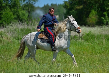MINSK REGION, BELARUS - JUNE 6: Russian lancer taking part in the historical reconstruction of fight in napoleonic war between Russian and French armies in 1812. June 6, 2015, Mejdurechye, Belarus - stock photo
