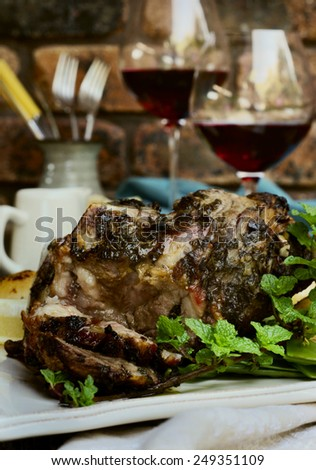 mint and garlic roast lamb. selective focus - stock photo