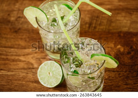 Mint and lime refreshing summer  cocktails - stock photo