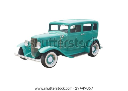 mint green four door sedan with whitewall tires - stock photo