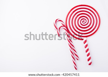 Mint hard candy cane striped in Christmas colours isolated on a  - stock photo