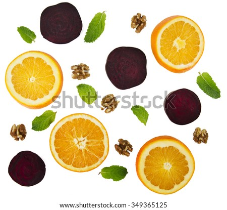 Mint leaves, walnuts, beets and oranges background - ingredients for a healthy fresh salad. - stock photo