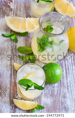 Mint lemonade in glasses and pitcher. Selective focus. - stock photo