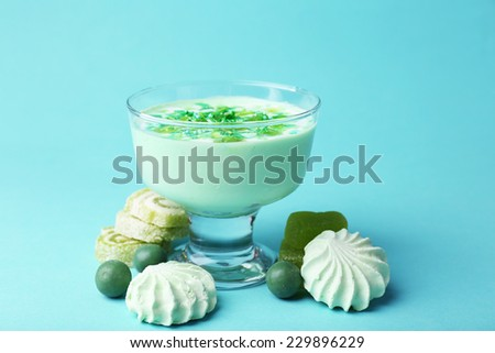 Mint milk dessert in glass bowl on color background