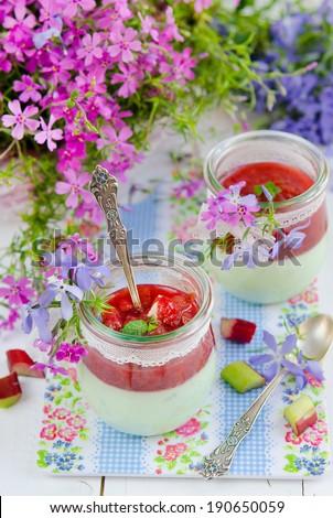 Mint panna cotta with rhubarb  - stock photo