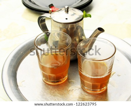 Mint tea: a kettle and a glass - stock photo