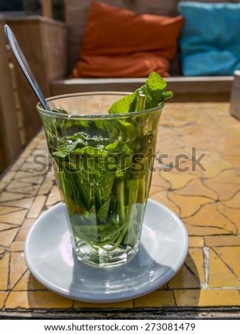 mint tea on a sunny terrace - stock photo