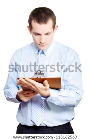 Minute taking businessman standing reading meeting notes attached to clipboard isolated on white background - stock photo