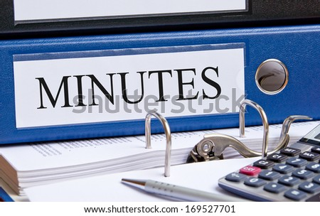Minutes - binder in the office with calculator and pen - stock photo