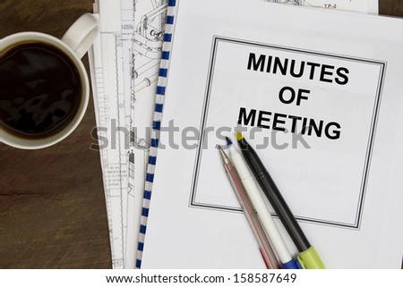 Minutes of meeting with coffee and engineering drawing. - stock photo