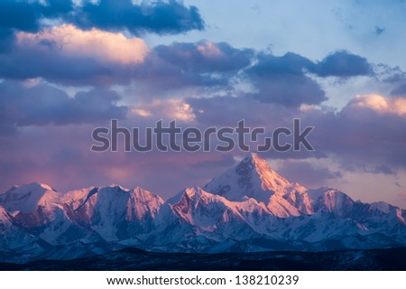 Minya Konka, the highest mountain in Sichuan, China, in the suns - stock photo