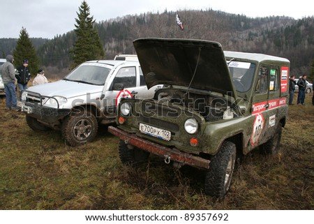 "MINYAR, RUSSIA - OCTOBER 31: Off-road vehicle UAZ (No.10) takes part at the annual trophy challenge ""Samhain"" on October 31, 2009 in Minyar, Chelyabinsk region, Russia."
