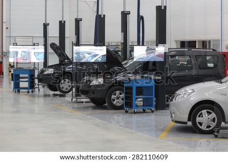 Mioveni, Romania - September 15, 2010: Color picture of Dacia Logan cars on the assembly line of the Dacia Renault factory. - stock photo