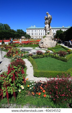 Mirabell Palace and its beautiful gardens in Salzburg, Austria. Recognizable faces have been blurred. - stock photo