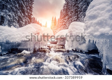 Miracle river at sunlight in the morning. Dramatic and picturesque wintry scene. Location Carpathian, Ukraine, Europe. Beauty world. Instagram toning effect. Glowing filter. - stock photo
