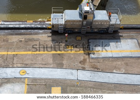 MIRAFLORES LOCKS, PANAMA, JANUARY 03: Trains (mules) side Panama Canal. These mules are used for side-to-side and braking control in the rather narrow locks on January 03 2014 in Panama City. - stock photo