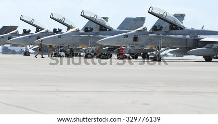 MIRAMAR, CA - OCT 3: Marine aviators and support crew work on F/A-18 Hornets during the air show in Miramar, CA on Oct 3, 2015. It's the largest military air show world-wide. - stock photo