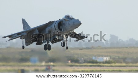 MIRAMAR, CA - OCT 3: McDonnell Douglas AV-8B Harrier II performs a vertical take-off at the Miramar Air Show in Miramar, CA on Oct 3, 2015. It's the largest military air show world-wide. - stock photo