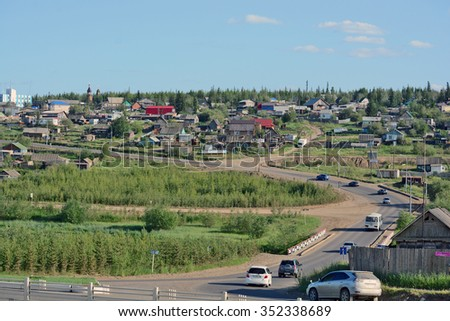Mirny, Russia - July 7, 2014: Rural area in the town of Mirny, Yakutia. Bridge on the River Irelyakh.