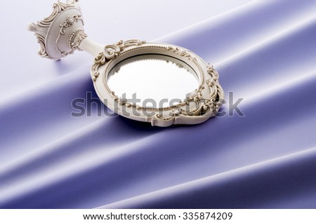 mirror and cloth drape