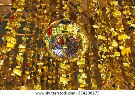 Mirror balls and gold tinsel decorated the hall a luxury hotel in the Chinese province of Shenzhen. Christmas is coming! - stock photo