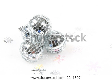Mirror Balls on white background with snowflakes - stock photo