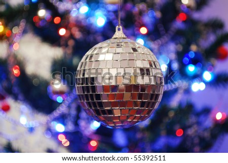 mirror disco ball giving off a party vibe at a discotheque - stock photo
