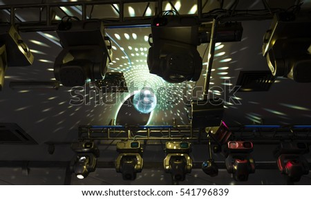 Mirror disco ball with reflected lights on the ceiling
