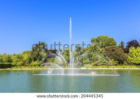 Mirror Fountain (1702). in gardens of famous Versailles palace. Palace of Versailles was a royal chateau. It was added to UNESCO list of World Heritage Sites. Paris, France. - stock photo