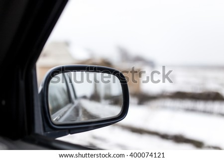 mirror in the car in motion - stock photo