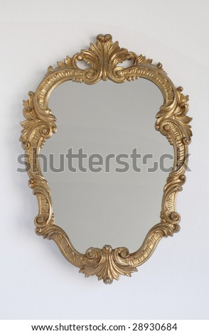 Mirror, Mirror on the wall. Disney looking princess mirror on blank wall with nothing reflected. Blank for copy. - stock photo