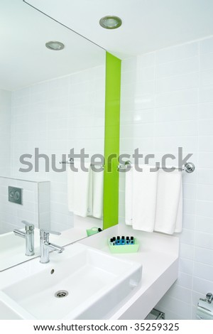 mirror on a wall of bathroom - stock photo