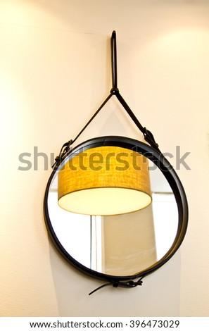 mirror on the wall, mirror on wall ,mirror on white background ,mirror ,denmark ,shop mirror ,coffee shop ,mirror reflection,big mirror ,light in mirror ,silver ,yellow ,light in mirror ,room ,make-up - stock photo