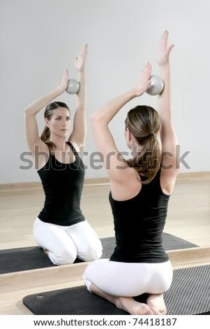 mirror pilates gym woman toning balls sport gym fitness girl - stock photo