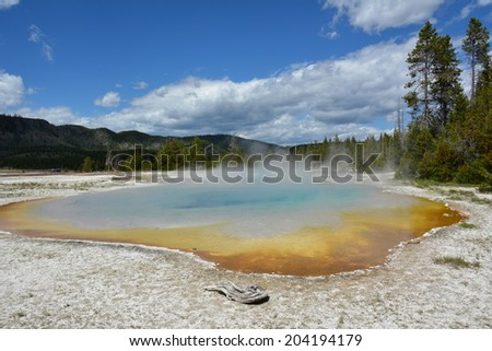 Mirror pool in the old road group of geysers near biscuit   geyser basin in yellowstone  national park, Wyoming - stock photo