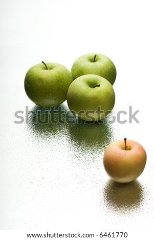 Mirror reflection of ripe apples. On a white background.