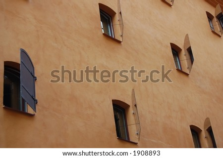 mirror shutters on windows in a house in Stockholm - stock photo