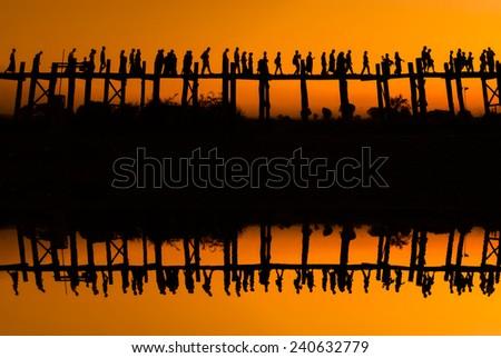 Mirror teak bridge U Bein. Burma. - stock photo
