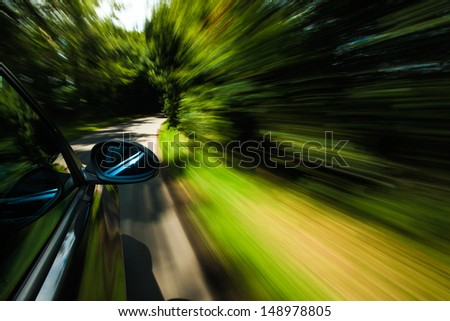 Mirror view of black car. - stock photo