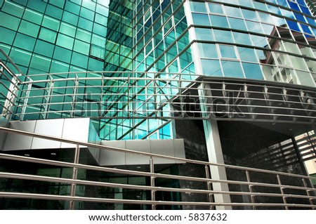mirror-walled business center with reflection of cloudy sky
