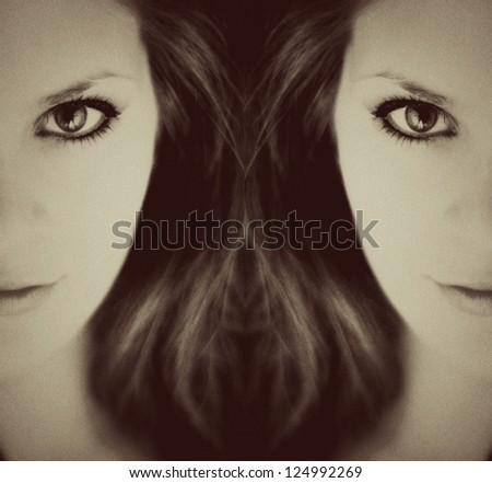 Mirrored image of young woman - stock photo