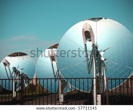 mirrored parabolic dish solar energy equipment - stock photo
