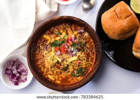 Misal Pav or misalpav, Misal Paav with Farsan. Traditional Indian spicy dish made with moth beans (match) and served with farina and bread
