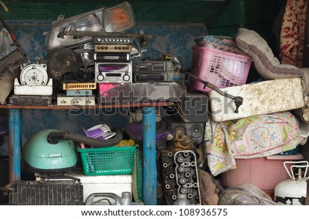 miscellaneous stuff stored in home workshop - stock photo