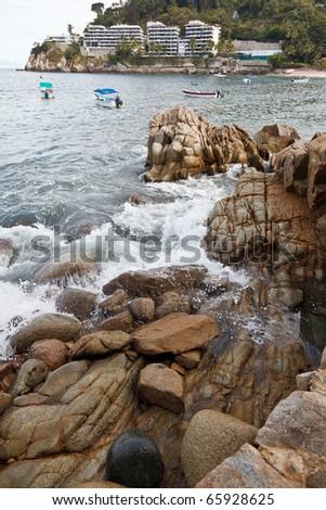 Mismaloya view from the rocky shore, near Puerto Vallarta, Mexico - stock photo