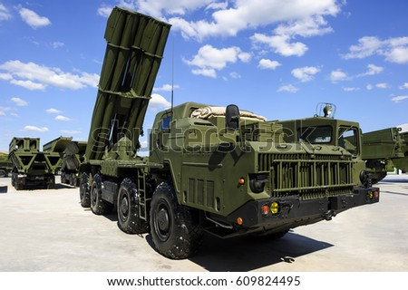 Missile launcher ready to attack on powerful heavy truck, modern military industry, antiaircraft forces, army machines, blue sky and white clouds on background