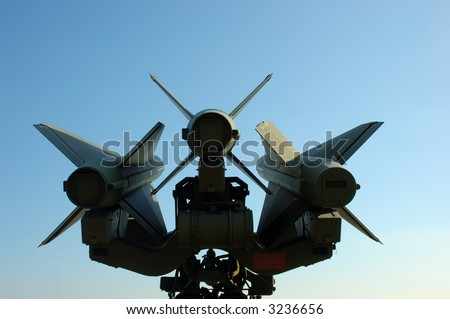 Missiles against blue sky - stock photo