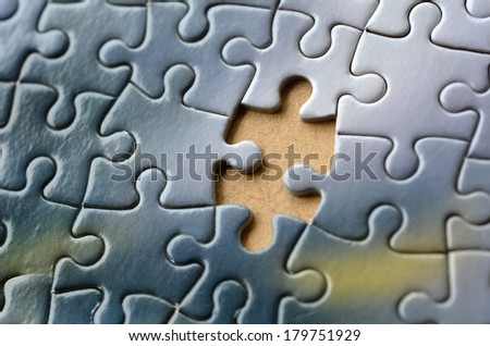 Missing jigsaw puzzle piece. Business concept for completing the final puzzle piece - stock photo