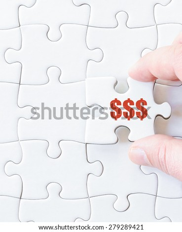 Missing jigsaw puzzle piece with dollar symbol.  Business concept image for completing the puzzle.